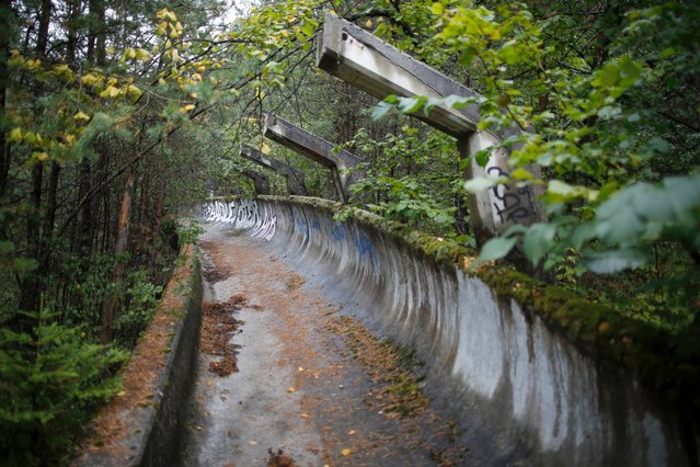 The disused bobsled track from the Sarajevo 1984 Winter Olympics is seen on Mount Trebevic, near Sarajevo, September 19, 2013. Abandoned and left to crumble into oblivion, most of the 1984 Winter Olympic venues in Bosnia's capital Sarajevo have been reduced to rubble by neglect as much as the 1990s conflict that tore apart the former Yugoslavia. (Photo by Dado Ruvic/Reuters)