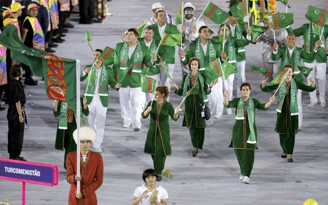 2016 Rio Olympics, Opening ceremony, Maracana, Rio de Janeiro, Brazil on August 5, 2016. Flagbearer Merdan Atayev (TKM) of Turkmenistan leads his contingent during the opening ceremony. (Photo by Stoyan Nenov/Reuters)