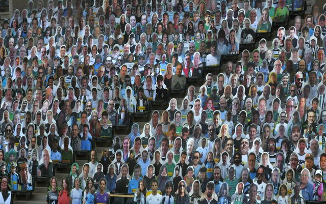 Cardboard cut-outs with portraits of Borussia Moenchegladbach's supporters are seen at the Borussia Park football stadium in Moenchengladbach, western Germany, on May 19, 2020, amid the novel coronavirus COVID-19 pandemic. (Photo by Ina Fassbender/AFP Photo)