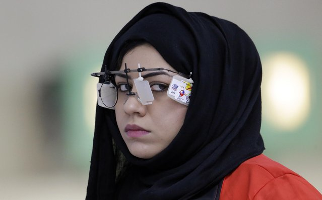 Oman's Wadha Nasiir Nasser Balushi competes in the qualification of the 10m Air Pistol Women at the Ongnyeon International Shooting Range for the 17th Asian Games in Incheon, South Korea, Saturday, September 20, 2014. (Photo by Lee Jin-man/AP Photo)