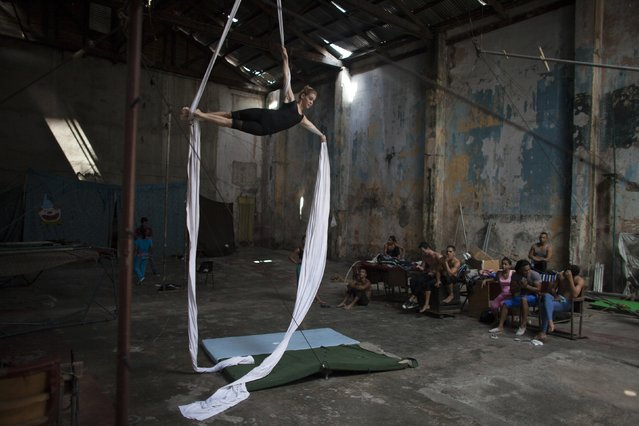 "Circus performer Adriana Gutierrez, 24, known as ""Cachita"", takes part in a training session in Havana, September 25, 2014. (Photo by Alexandre Meneghini/Reuters)"