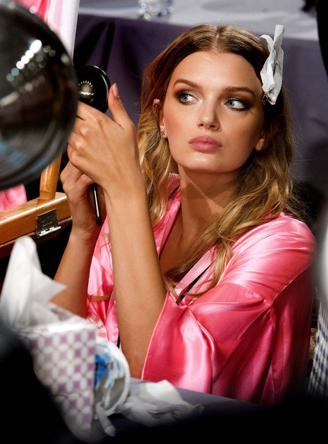 Lily Donaldson appears backstage in hair and makeup at The Victoria's Secret Fashion Show in New York. (Photo by Charles Sykes/Evan Agostini)