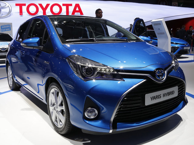 A Toyota Yaris Hybrid car is displayed on media day at the Paris Mondial de l'Automobile, October 2, 2014. (Photo by Jacky Naegelen/Reuters)