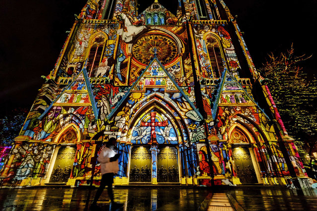 A light construction made by Daniel Margraf projected on the Catharina Church during Glow, the annual light art festival in Eindhoven, The Netherlands, 12 November 2017 . With their light installations, dozens of light artists give Eindhoven's city center an entirely new face. (Photo by Robin van Lonkhuijsen/EPA)