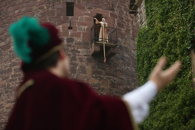 Rapunzel, actually 13-year-old actress Anna Helver, prepares to let down her hair to her prince, played by actor Daniel Stuebe, from a tower balcony of Trendelburg Castle on November 18, 2012 in Trendelburg, Germany. Rapunzel is one of the many stories featured in the collection of fairy tales collected by the Grimm brothers, and the 200th anniversary of the first publication of the stories will take place this coming December 20th. Anna and another actor perform a skit based on the Rapunzel tale to visitors at Trendelburg Castle, which is now a hotel, every Sunday. The Grimm brothers collected their stories from oral traditions in the region between Frankfurt and Bremen in the early 19th century, and the works include such global classics as Sleeping Beauty, Little Red Riding Hood, The Pied Piper of Hamelin, Cinderella and Hansel and Gretel.  (Photo by Sean Gallup)