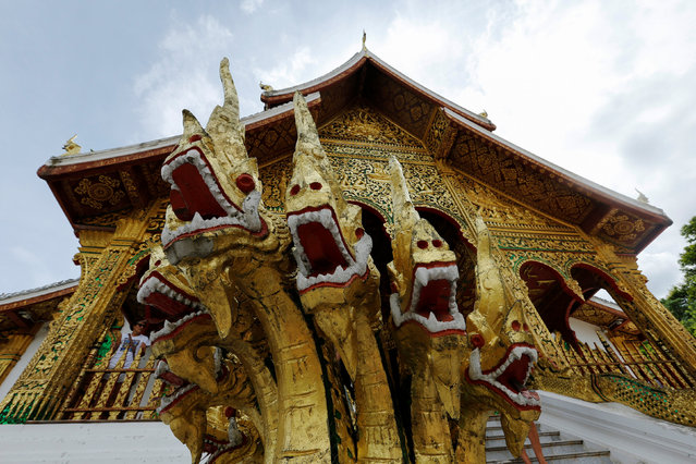 A sculpture of Nagas, or serpent deities, is seen at the entrance of Haw Pha Bang Buddhist temple in Luang Prabang, Laos July 31, 2016. (Photo by Jorge Silva/Reuters)