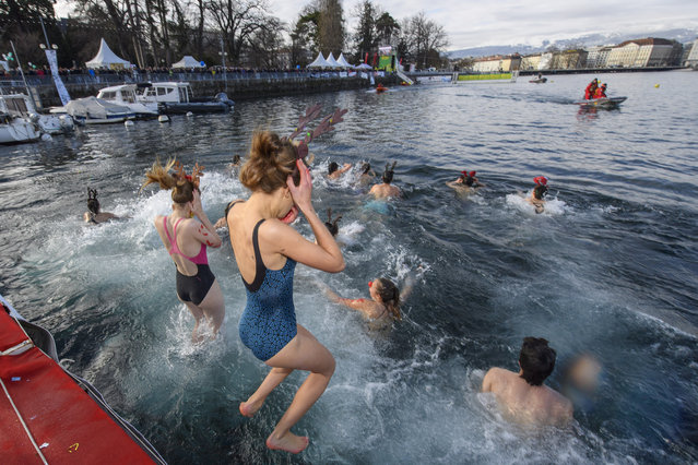 "Participants of the 79th edition of the annual Christmas swimming ""Coupe de Noel"" jump into the Lake Geneva, in Geneva, Switzerland, Sunday, December 17, 2017. More than 2000 men and women swam the 120 meters at the traditional Christmas swimming in Geneva where the water temperature was 6 degrees. (Photo by Martial Trezzini/EPA/EFE/Rex Features/Shutterstock)"