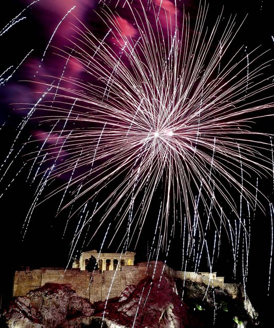 Fireworks explode over Acropolis Hill and the Parthenon during celebrations in Athens. (Photo by Dimitri Messinis/Associated Press)
