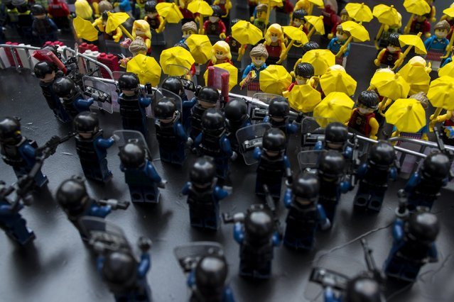 Toy Lego characters depicting a scene of protesters confronting riot police are seen on a table outside the government headquarters in Hong Kong October 20, 2014. A deepening sense of impasse gripped Hong Kong on Monday as pro-democracy protests entered their fourth week, with the government having limited options to end the crisis and demonstrators increasingly willing to confront police. (Photo by Tyrone Siu/Reuters)