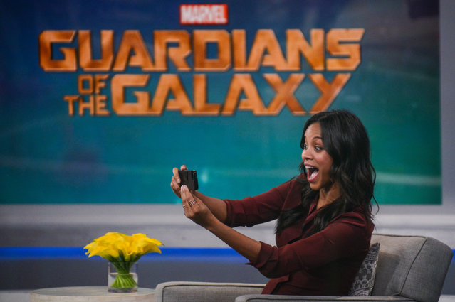 "Actress Zoe Saldana takes a selfie picture at ""Good Morning America"" at the ABC Times Square Studios on July 28, 2014 in New York City. (Photo by Ray Tamarra/GC Images)"