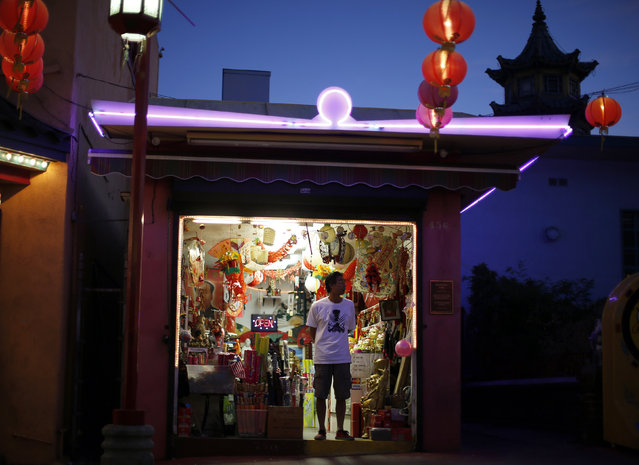 A man stands in a store selling lanterns in Chinatown in Los Angeles, California August 13, 2014. (Photo by Lucy Nicholson/Reuters)