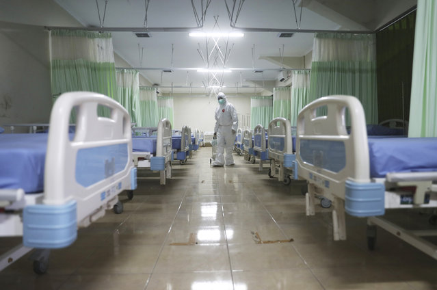 A medics inspects makeshift isolation rooms at Patriot Candrabhaga stadium prepared to become a quarantine facility for people showing symptoms of the COVID-19 amid the new coronavirus outbreak in Bekasi on the outskirts of Jakarta, Indonesia, Wednesday, September 9, 2020. While Indonesia has recorded more deaths from the coronavirus than any other Southeast Asian country, it also has seen by far the most fatalities among medical workers in the region, leading to concerns about the long-term impact on the nation's fragile healthcare system. (Photo by Achmad Ibrahim/AP Photo)