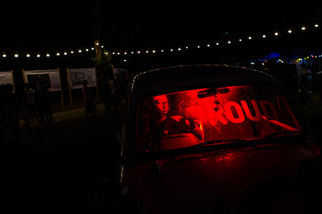 """This photo taken on January 28, 2018 shows a man inside a car attending the """"&Proud"""" LGBT festival in Yangon. (Photo by Ye Aung Thu/AFP Photo)"""