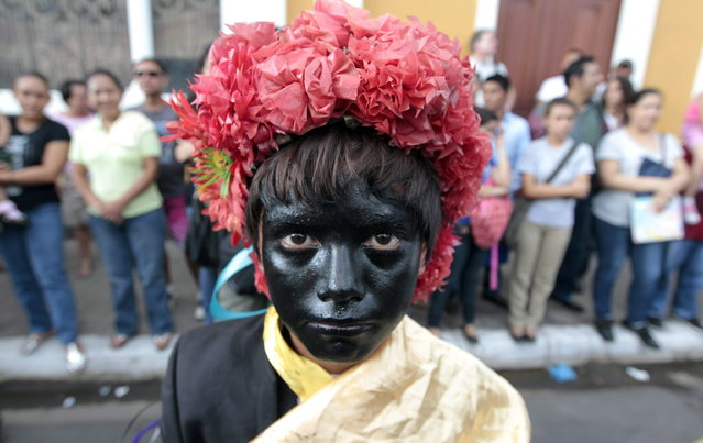 A dancer with his face painted with black oil takes part in the IX International Festival of Poetry in Granada city, about 45 km (28 miles) south of Managua, February 20, 2013. About 300 poets from around the world along with Nicaraguans participated in the IX international poetry festival dedicated to Nicaraguan poet Ernesto Cardenal who won the Queen Sofia Prize of 2012. (Photo by Oswaldo Rivas/Reuters)