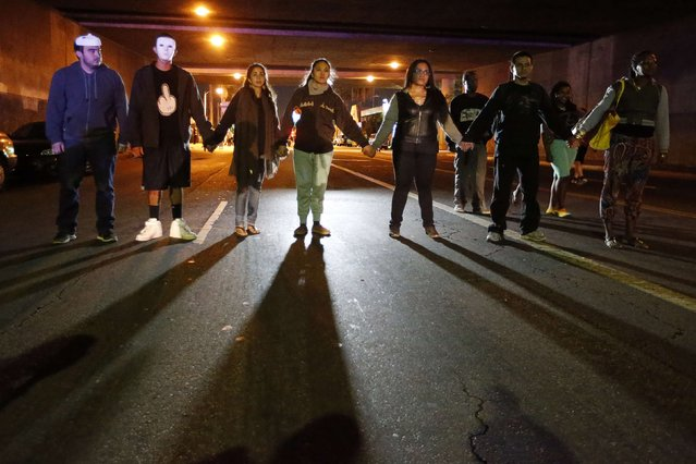 Protesters face off against police during a demonstration in Los Angeles, California November 24, 2014, following the grand jury decision in the shooting of Michael Brown in Ferguson, Missouri. (Photo by Lucy Nicholson/Reuters)