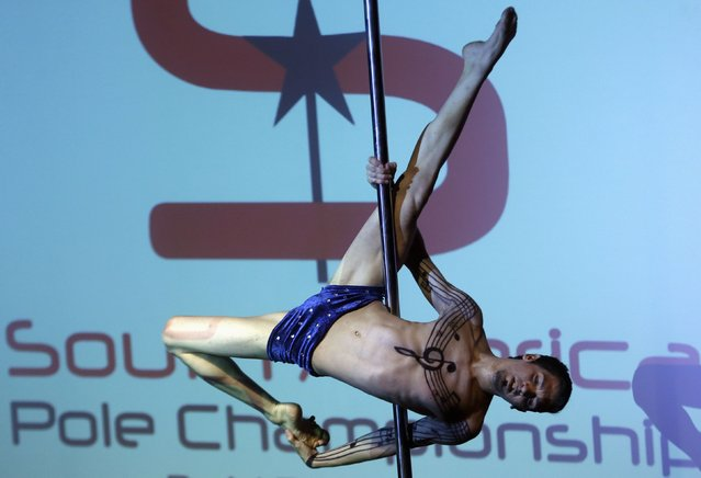 Lucas Alvarez, of Argentina, competes in the South American Pole Dancing Championship in Buenos Aires November 24, 2014. (Photo by Enrique Marcarian/Reuters)