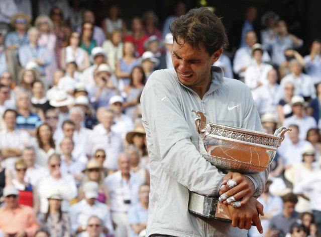 Rafael Nadal of Spain cries during the trophy ceremony after defeating Novak Djokovic of Serbia during their men's singles final match to win the French Open tennis tournament at the Roland Garros stadium in Paris, in this June 8, 2014 file photo. (Photo by Jean-Paul Pelissier/Reuters)