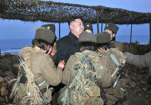 Kim Jong Un talks with soldiers of the Korean People's Army (KPA) taking part in the landing and anti-landing drills of KPA Large Combined Units 324 and 287 and KPA Navy Combined Unit 597, on March 25, 2013. (Photo by Reuters/KCNA)