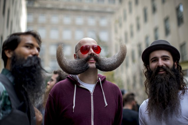 MJ Johnson (C) and other contestants gather to promote the National Beard and Moustache Championships in New York November 6, 2015. The National Beard and Moustache Championships will take place on November 7, 2015 in Brooklyn, New York and will feature contestants from all over the world. (Photo by Brendan McDermid/Reuters)