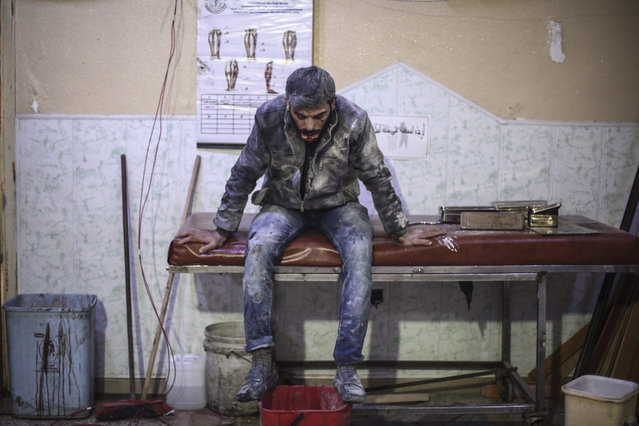 A Syrian man sits in a field hospital after he got injured in an airstrike by forces loyal to the Syrian government in the rebel-held area of Douma, outskirts of Damascus, Syria, 07 November 2015. More than ten people died according to local activists. (Photo by Mohammed Badra/EPA)