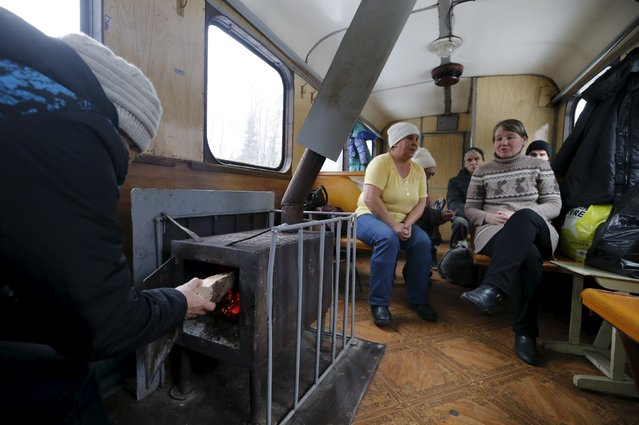 People travel inside a train on the route from Ugolnaya station to Elnichnaya station in Sverdlovsk region, Russia, October 16, 2015. (Photo by Maxim Zmeyev/Reuters)