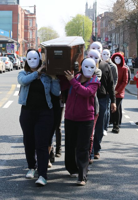 Rialto Youth Project Youth workers will staging a symbolic funeral ceremony outside the Department of Children and Youth Affairs, Mespil Road, Dublin highlighting  the impact of funding cuts on services for young people, on May 7, 2013. (Photo by Gareth Chaney Collins)