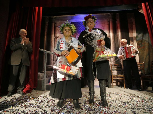 "Lida Maisuradze, 82, (L) and Zurab Gogidze, 82, celebrate after wining the ""Super Grandmother and Super Grandfather"" contest in Tbilisi, January 5, 2015. Twenty-two participants aged over 70 from all over Georgia competed in the annual contest organised by charity house Catharsis. (Photo by David Mdzinarishvili/Reuters)"