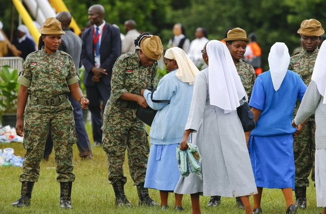 Kenyan army soldiers check nuns as they arrive to attend a meeting with Pope Francis in Kenya's capital Nairobi, November 26, 2015. (Photo by Stefano Rellandini/Reuters)