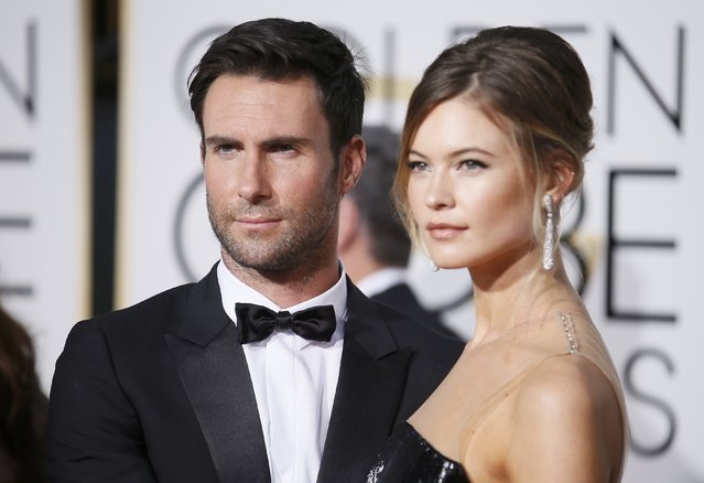 Musician Adam Levine and Behati Prinsloo arrive at the 72nd Golden Globe Awards in Beverly Hills, California January 11, 2015. (Photo by Danny Moloshok/Reuters)