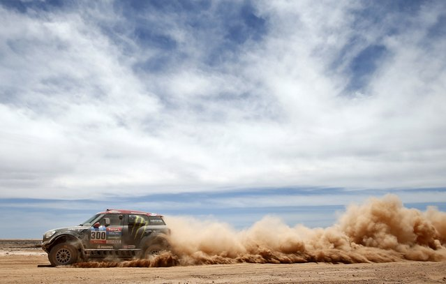 Mini driver Nani Roma of Spain drives during the 9th stage of the Dakar Rally 2015 from Iquique to Calama January 13, 2015. (Photo by Jean-Paul Pelissier/Reuters)