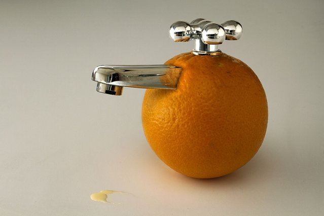 An orange with a faucet. (Photo by Giuseppe Colarusso/Caters News)