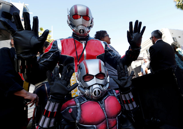 """Fans in costumes gesture at the premiere of the movie """"Ant-Man and the Wasp"""" in Los Angeles, California, U.S. June 25, 2018. (Photo by Mario Anzuoni/Reuters)"""