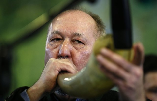 "A competitor uses an ox horn at the German championships in Deer-Calling at the ""Jagd & Hund"" exhibition in Dortmund February 6, 2015. (Photo by Ina Fassbender/Reuters)"
