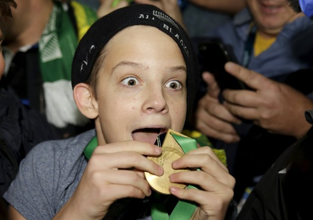 A boy displays the winners' medal given to him by Sonny Bill Williams of New Zealand after the Rugby World Cup Final against Australia at Twickenham in London, Britain, October 31, 2015. (Photo by Henry Browne/Reuters)