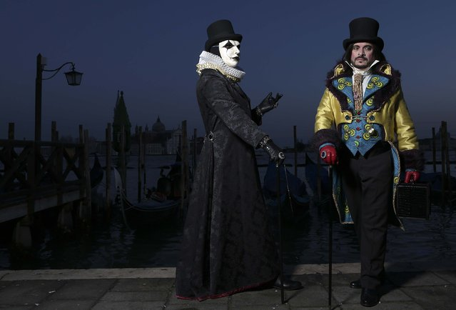 Revellers pose in front of St. Mark's Square during the Venice Carnival, February 7, 2015. (Photo by Stefano Rellandini/Reuters)