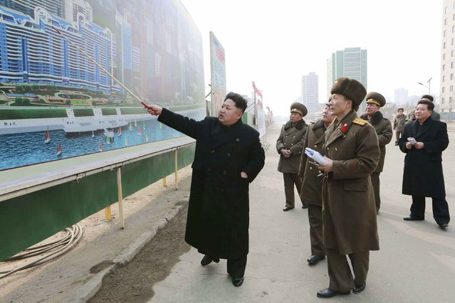 North Korean leader Kim Jong Un (L) issues instructions while visiting the construction site of the Mirae Scientists Street in Pyongyang in this undated photo released by North Korea's Korean Central News Agency (KCNA) in Pyongyang February 15, 2015. (Photo by Reuters/KCNA)