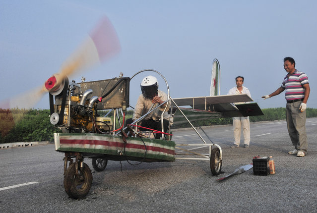Ding Shilu (L) tests the engine of his home-made aircraft before conducting a test flight on the outskirts of Shenyang, Liaoning province, August 6. 2013. Ding, a 65-year-old migrant worker, spent around 2,000 yuan ($327) to build this 5-metre-long, 4.5-metre-high plane using components from motorcycles and electric bicycles. Ding failed his fourth test flight on Tuesday since he started his project four years ago, local media reported. (Photo by Sheng Li/Reuters)