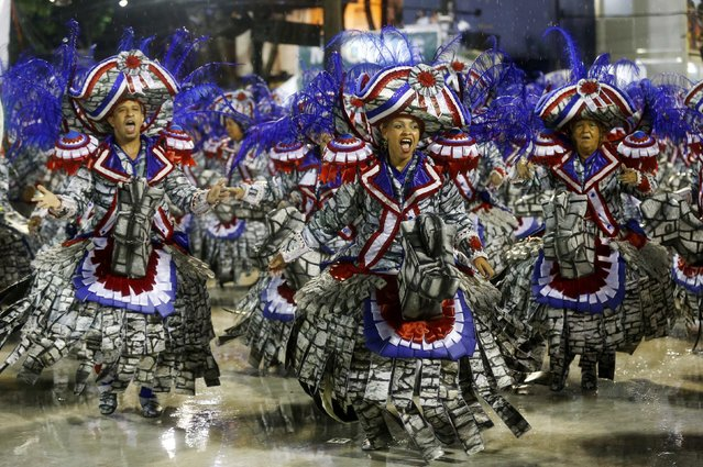 Revellers from the Mocidade samba school participate in the annual carnival parade in Rio de Janeiro's Sambadrome, February 16, 2015. (Photo by Sergio Moraes/Reuters)