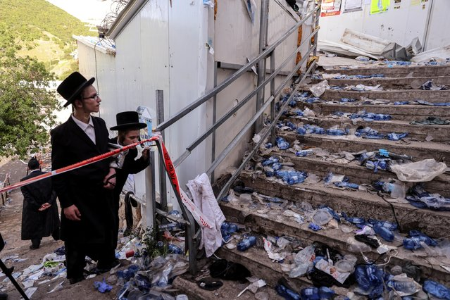 Ultra Orthodox Jews look at stairs with waste on it in Mount Meron, northern Israel, where fatalities were reported among the thousands of ultra-Orthodox Jews gathered at the tomb of a 2nd-century sage for annual commemorations that include all-night prayer and dance, April 30, 2021. A stampede at a religious festival attended by tens of thousands of ultra-Orthodox Jews in northern Israel killed dozens of people and injured more than 100 others early Friday, medical officials said, in one of the country's deadliest civilian disasters. (Photo by Ronen Zvulun/Reuters)