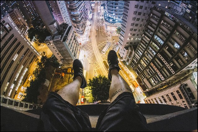 Daredevil photographer Andrew Tso has risked life and limb by taking a series of stunning images from the rooftops of Hong Kong's giant skyscrapers. (Photo by Andrew Tso/Barcroft Media)