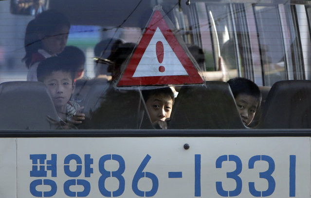 North Korean students travel in a school bus in Pyongyang July 25, 2013. (Photo by Jason Lee/Reuters)