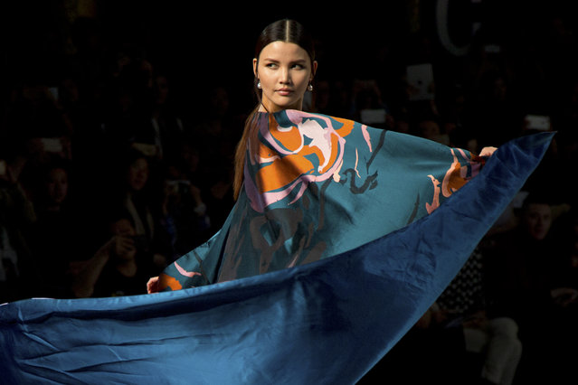 A model presents a creation by Chinese designer Zeng Fengfei, winner of the Asahi Kasei Chinese Fashion Designer Creativity Award, during China Fashion Week in Beijing, Sunday, March 29, 2015. (Photo by Mark Schiefelbein/AP Photo)