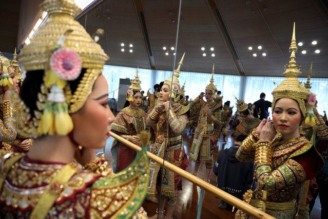 Dancers get ready backstage before a performance of masked theatre known as Khon which was recently listed by UNESCO, the United Nations' cultural agency, as an intangible cultural heritage, along with neighbouring Cambodia's version of the dance, known as Lakhon Khol at the Thailand Cultural Centre in Bangkok, Thailand on November 7, 2018. (Photo by Jorge Silva/Reuters)