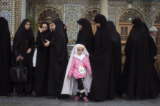 Voters line up to cast their ballots at a polling station in the city of Qom, Iran. Elections for Iran's parliament (Majlis) and Assembly of Experts kicked off on Friday, February 26, 2016. (Photo by Ahmad Halabisaz/Xinhua via ZUMA Wire)