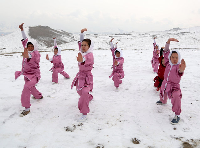 Afghan girl athletes perform Wushu on the top of a hill in Kabul, capital of Afghanistan, January 18, 2017. In the conservative Afghan society where people especially in the countryside deeply believe in the old traditions and don't allow their girls and female members of the family to go out of home, exercising sport in open is extremely risky, but a group of girls are broken the taboo and exercising Wushu on a hilltop where the temperature is minus 2 Celsius degrees. (Photo by Rahmat Alizadah/Xinhua/Barcroft Images)