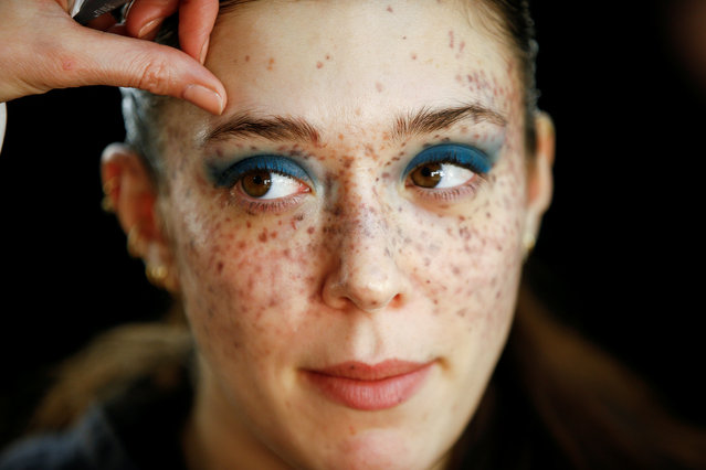 A model prepares backstage of the House of Holland catwalk show during London Fashion Week Women's A/W19 in London, Britain February 16, 2019. (Photo by Henry Nicholls/Reuters)