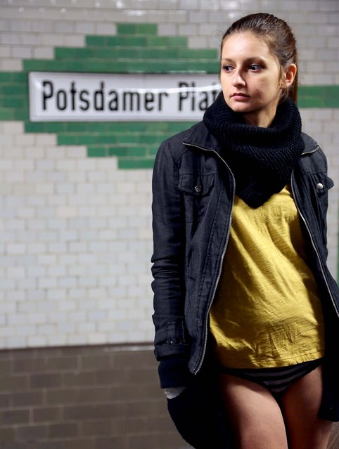A participant in the No Pants Subway Ride waits for a train in Berlin. (Photo by Adam Berry/Getty Images)