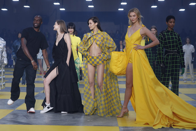 Designer Virgil Abloh, from left, poses with models Gigi Hadid, Bella Hadid and Karlie Kloss at the conclusion of the Off-White ready to wear Fall-Winter 2019-2020 collection, that was presented in Paris, Thursday, February 28, 2019. (Photo by Thibault Camus/AP Photo)