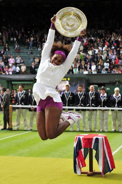 US player Serena Williams celebrates with the trophy, the Venus Rosewater Dish after her women's singles final victory over Poland's Agnieszka Radwanska on day 12 of the 2012 Wimbledon Championships tennis tournament at the All England Tennis Club in Wimbledon, southwest London, on July 7, 2012. (Photo by Glyn Kirk/AFP Photo)