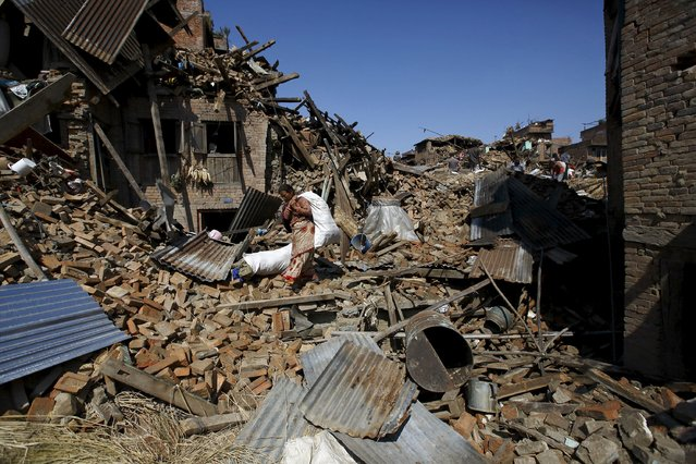 A woman carrying a sack of belongings walks amidst the rubble of collapsed houses after Saturday's earthquake in Bhaktapur, Nepal April 27, 2015. (Photo by Navesh Chitrakar/Reuters)
